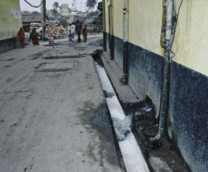 Untreated Effluent gushing out of a Hazaribagh tannery (left photo) eventually reaches a stream that flows into the Buriganga River.