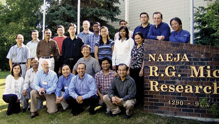 BIG TEAM Hernandez, front row, fifth from left, poses during a research meeting at Naeja's headquarters.