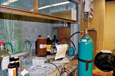 DETONATION: Near the blast scene remain two trays of purple nickel hydrazine perchlorate residue.