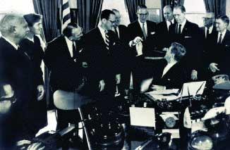 President Kennedy signing the 1962 Kefauver-Harris Amendments to the Food & Drug Act into law. He is handing the pen to former Sen. Estes Kefauver (D-Tenn.)