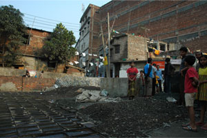 Leather Recycling: Glue (left) and fish and chicken feed dry on the ground in a residential part of Hazaribagh.