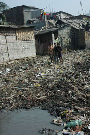Playground: Children play in garbage and tannery effluent in the recyclers' area of Hazaribagh.