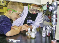 Kids observe a chemical reaction during an event hosted by the Illinois-Iowa Section.