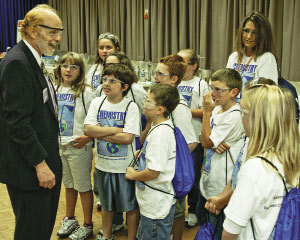 Bursten speaks to kids during a Northeast Tennessee Section event at Eastman Chemical.