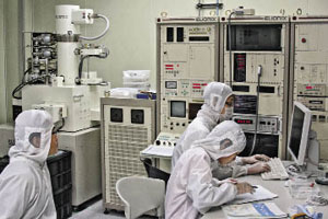 Students pursue a research project in the Institute of Physics' clean room facility.