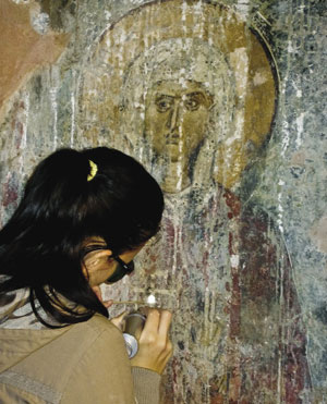 FieldWork A mobile Nd:YAG laser is being used to remove salts from a fresco on a church wall.