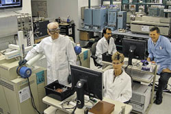 DETECTIVES: At the FBI Lab, Schaff (clockwise from left) and his colleagues Eshwar Jagerdeo, Michael Rickenbach, and Eileen Waninger use high-tech instruments in their daily work.