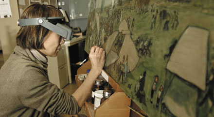 CHEMISTRY AND ART: Working at the Museum Conservation Institute, Tsang retouches a painting from the Smithsonian National Air & Space Museum.