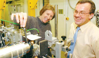 CHECK IT OUT Michigan's Smith (left) and Advanced Photon Source Director Murray Gibson examine beamline equipment at Argonne National Laboratory.